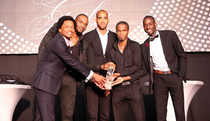 TT Olympic Committee boss Brian Lewis, left, joins World 4x400m champs (from left) Lalonde Gordon, Machel Cedenio, Renny Quow and Jereem Richards after they won the TTOC Sportsman of the Year award on Friday at the Hyatt Regency, Port of Spain.