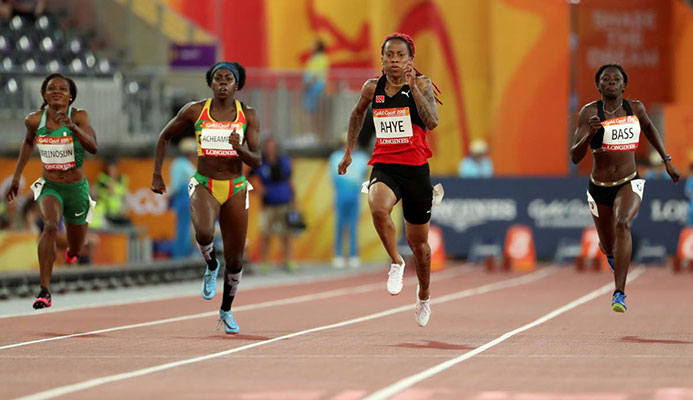 Trinidad and Tobago's Michelle-Lee Ahye, second right, leads the field to win her women's 100m semifinal at the Carrara Stadium during the 2018 Commonwealth Games on the Gold Coast, Australia, yesterday.