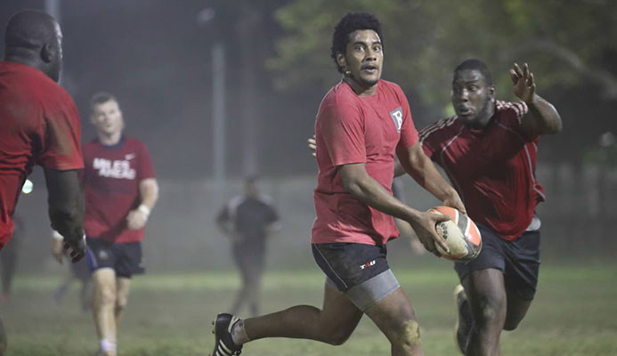 FLASHBACK: Fiji-born Sefanaia Waqa runs with the ball during a national training session earlier this year. Waqa is on the TT team currently competing at the Rugby Americas North Sevens Championship in Barbados. PHOTO BY ALLAN V CRANE/CA-IMAGES
