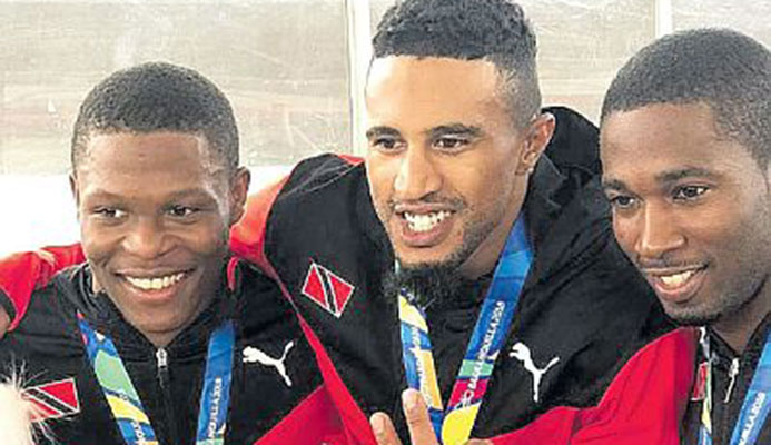 T&T men's cycling sprint team from left, Nicholas Paul, Njisane Phillip and Kwesi Browne sporting their gold medals won during yesterday's sprint event.