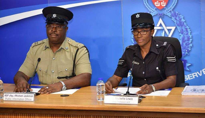 PROTECT OUR YOUTHS: Sgt Michelle Lewis of the Child Protection Unit and Acting ASP Michael Jackman at police press briefing at Police Administration Building in Port of Spain. PHOTO COURTESY TT POLICE SERVICE