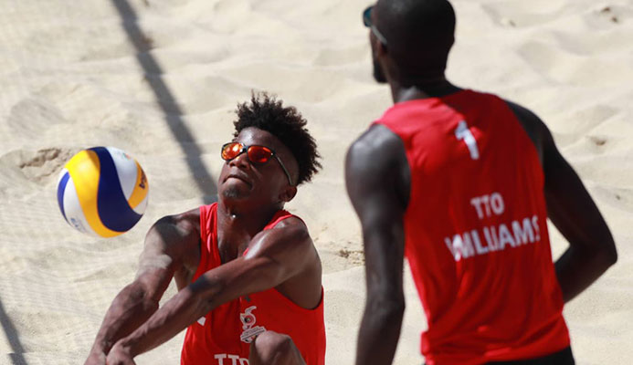 Team TTO's Men's Beach Volleyball team (Red shirt, Black shorts), Daneil Williams (#1) and Daynte Stewart (#2) Photo: Allan V. Crane