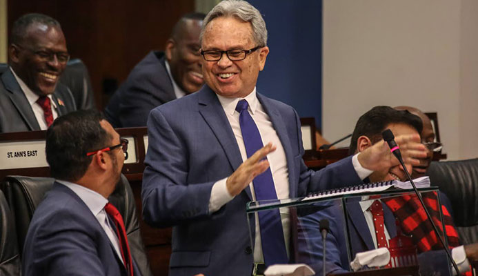 Minister of Finance Colm Imbert smiles during his presentation of the National Budget,yesterday,in Parliament.