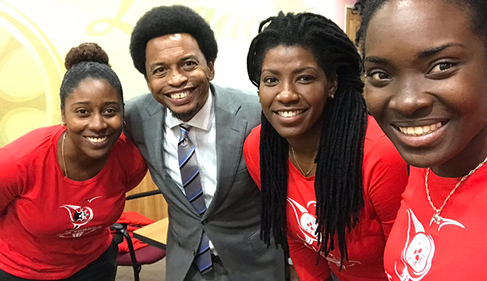 Trinidad and Tobago Olympic Committee President Brian Lewis with Rheeza Grant, Kwanieze John and Chanelle Young, the driving forces behind the country's successful bid to host the 2021 Commonwealth Youth Games ©TTOC