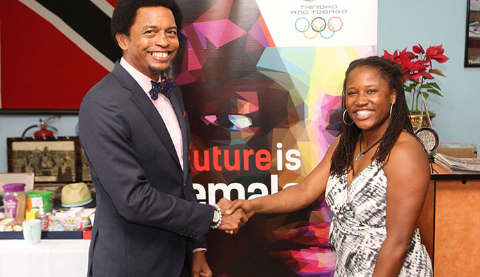 American Lauryn Williams, a four-time Olympian, with T&T Olympic Committee president Brian Lewis at Olympic House on Abercromby Street, Port-of-Spain, yesterday ahead of the three-time Olympic medallist's discussion on her athletic career and life thereafter.
