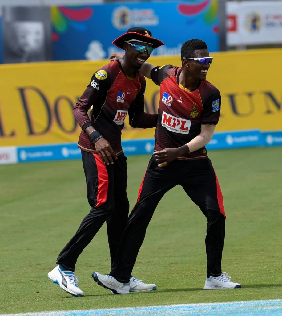 In this file Sep 2 file photo, Khary Pierre (left) and Akeal Hosein of Trinbago Knight Riders celebrate the dismissal of Alzarri Joseph of St Kitts/Nevis Patriots during the teams' Hero Caribbean Premier League match 23 at the Brian Lara Cricket Academy, Tarouba. (Photo by CPL T20 via Getty Images) -