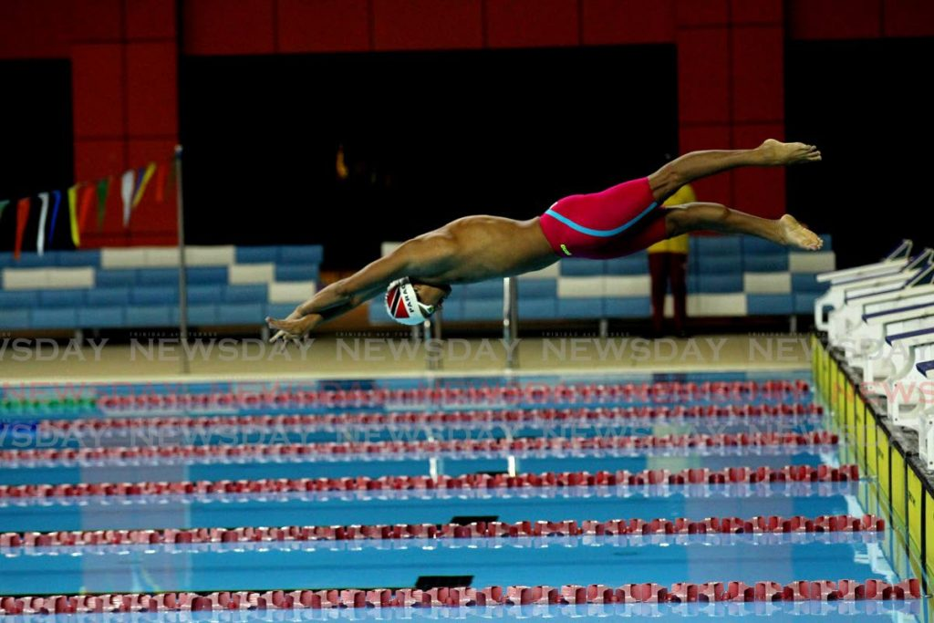 Josiah Parag takes part in the Amateur Swimming Association of Trinidad and Tobago's Boys 200m individual medley long course trials, at the National Aquatic Centre, Couva, on Monday night. - Lincoln Holder