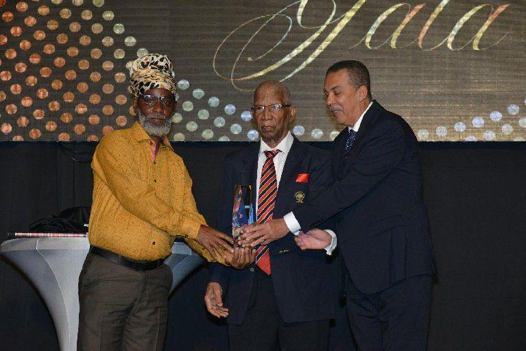 Alexander B Chapman award presented to Anthony 'Dada' Wickham,left, with . Alexander Chapman, centre, and His Excellency Anthony Carmona