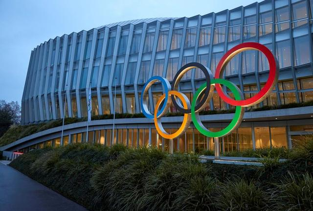FILE PHOTO: The Olympic rings are pictured in front of the International Olympic Committee (IOC) in Lausanne, Switzerland, December 7, 2020. REUTERS/DENIS BALIBOUSE/FILE PHOTO