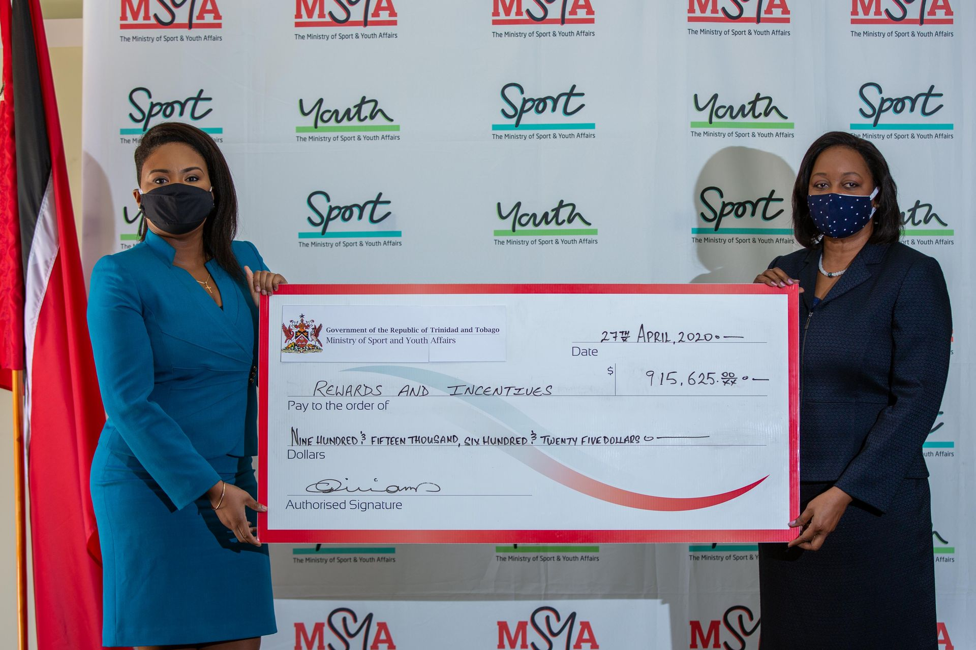 Sports and Youth Affairs Minister Shamfa Cudjoe and Permanent Secretary Claire Davidson-Williams sports the cheque for the Rewards and Incentives Programme. Cheques for different sums were distributed to several T&T athletes on Wednesday.  Kerron Savory
