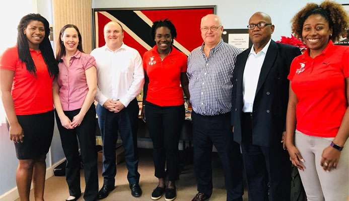 ULTIMATELY SUCCESSFUL MEETING: In this photo taken in February, Trinidad and Tobago bid representatives Rheeza Grant, left, Kwanieze John, centre, and Chanelle Young, right, pose with members of the Commonwealth Games Federation (CGF) inspection team during their visit to Trinidad. The CGF announced on Friday that T&T won the bid to host the 2021 Commonwealth Youth Games. Gibraltar was the other contender.